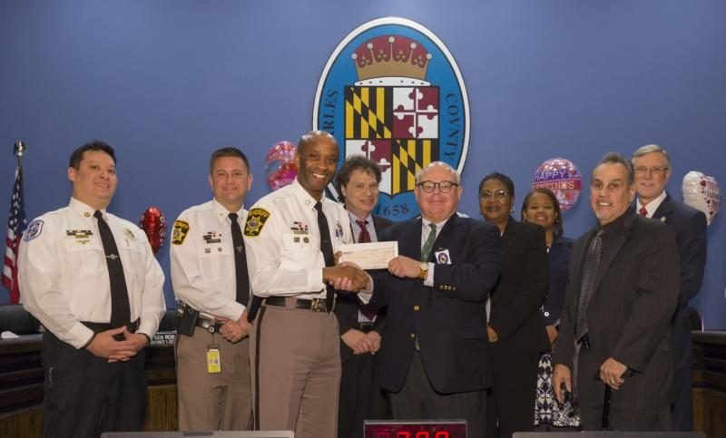 The Charles County Board of Commissioners with representatives from the Charles County Sheriff's Office, Local Government Insurance Trust and the Charles County Department of Emergency Services.