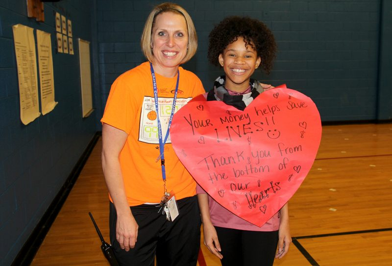 """Milton M. Somers Middle School students and staff recently participated in the American Heart Association's Hoops For Heart event. Students raised donations and joined basketball teams for a chance to play basketball against their teachers. Somers physical education teacher Brooke Lyon, left, helped to organize the event, which eighth grader Nhyjah Taylor, right, said was """"cool."""" The school raised more than $4,500 for the cause."""