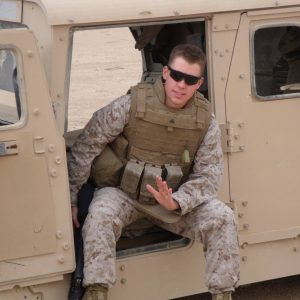 Former Marine Corps Cpl. Ryan Daniels sits in a Humvee near Habbaniyah, Iraq, in March 2009. Daniels now works as a Naval Air Systems Command Naval Acquisition Development Program intern supporting the Maritime Patrol and Reconnaissance Aircraft Program Office (PMA-290). Photo courtesy of Ryan Daniels.