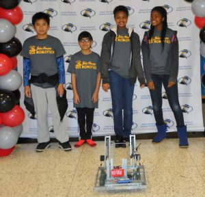 John Hanson Middle School seventh graders Kritchanin Yampai, left, Parth Madaan, Sydney Lewis and Gaciella Ndjampa are members of the school's Pro Vex Masters team which won the Judge's Award at the VEX Robotics Competition Feb. 4 at the College of Southern Maryland. Daniel Meltsner, technology education teacher, is the coach of Hanson's four VEX Robotics teams.