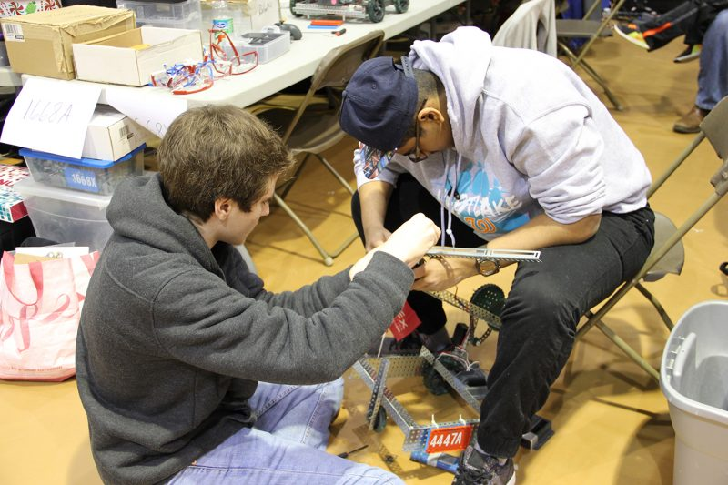 Westlake High School sophomores Matthew Maieli, left, and Brian Thomas put the final touches on their VEX Robotics project.