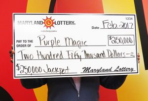 """Purple Magic"" Reigns Supreme for $250,000 Waldorf Scratch-off Winner"