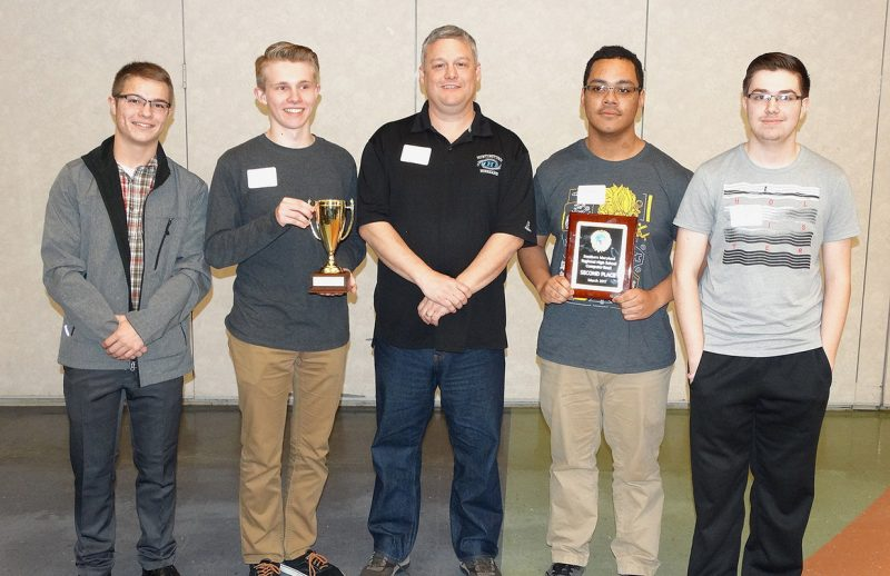 Second-place team: Huntingtown High School, Calvert County From left, Zach Sims, Brian Holt, coach Tom Currier, John Murray, and Brandon Jackson.
