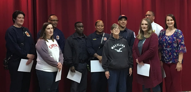 Crew recognized by Fire Chief Barksdale for saving the life of a sudden cardiac arrest victim. Patient, in MARYLAND shirt, is alive and well and thanked everyone involved at an award ceremony in Accokeek on Tuesday evening. (Photo by PGFD)