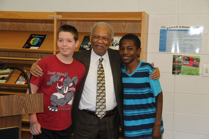 Rev. Reginald Green, center, greets Theodore G. Davis Middle Schools seventh graders David Hemsley, right, and Brock Boles, left, after he speaks with students about his experiences as Freedom Rider during the civil rights movement in the 1960s. Green was invited to Davis by social studies teacher Duania Darby to talk with her classes about the civil rights movement as part of their unit on Black History Month.