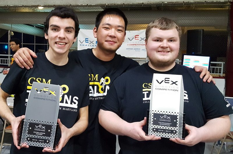 Members of the CSM Talons, from left, Ed Gesser of Mechanicsville, Wen Xing Lin of St. Leonard and George Jenkins of La Plata, celebrate their Excellence and Tournament Champion awards won at a March 10 tournament. The awards qualified the team for the VEX-U World Championship.