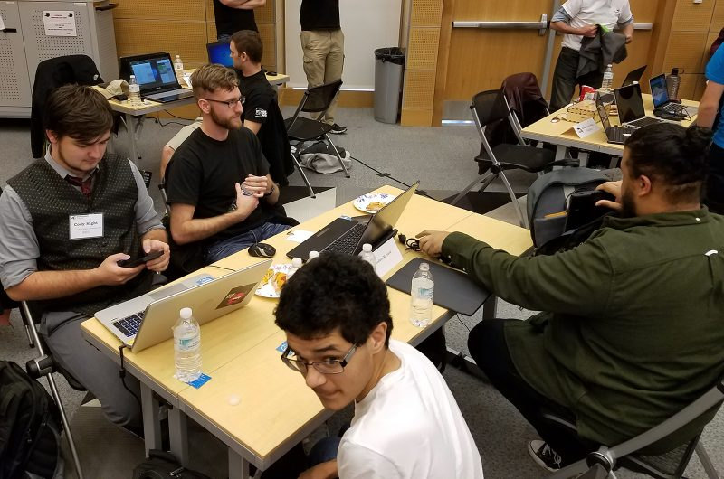 The CSM Cyberhawks compete at the Maryland Community College Cyber Competition held April 7 at the Montgomery Community College Germantown Campus, including, far left then clockwise around the table, team members Cody Hight, Caleb Craft and Don Price, sitting with CSM club member James Graves, who did not compete.