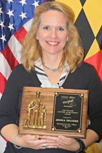 Corporal Angela Delozier receives Sam Walker Lifetime Achievement Award