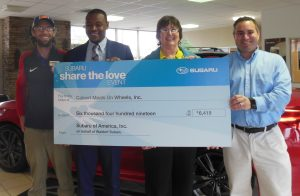 Calvert Meals on Wheels Accepts Check from Waldorf Subaru