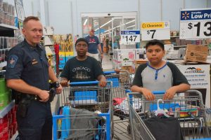 Shop with a Cop Equips Students with Back to School Gear