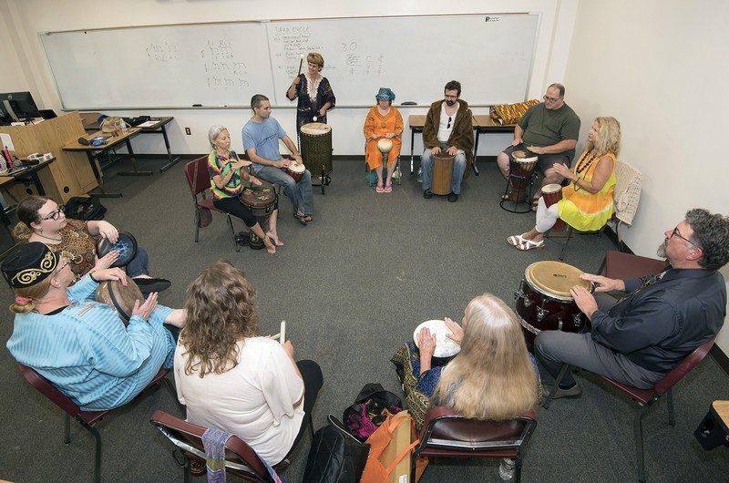 Sheila Klotz, standing, leads the Drum Circle personal enrichment class at CSM's Leonardtown Campus.