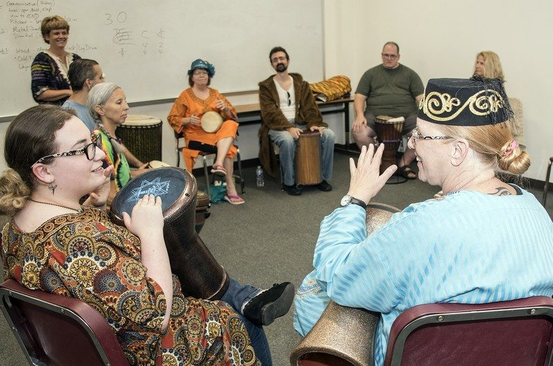 Emily Harris, left, and Shirley Steffey work to match rhythms in CSM's Drum Circle class at the Leonardtown Campus.