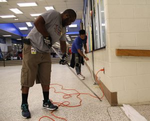 Building service workers prepare for school year