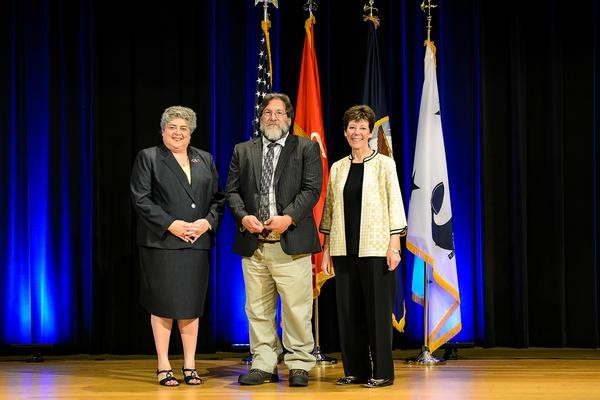 David Kotick, center, won in the Individual Engineers division. He's flanked on the left by Allison Stiller, Assistant Secretary of the Navy (Research, Development and Acquisition) (Performing the duties of) and on his right by Dr. Delores Etter. Photos are unavailable for award presentations to Bradley Yost, who won in the Emergent Scientist Investigators division, and Dr. Oliver Allen, who won in the Individual Scientist division.