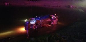 Two Occupants Avoid Injury When SUV Crashes into Pond