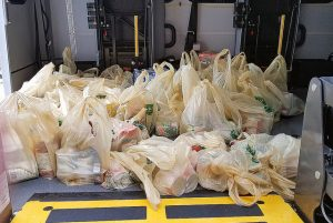 Stuff the Bus Food Drive Campaign Yields Hundreds of Pounds of Food