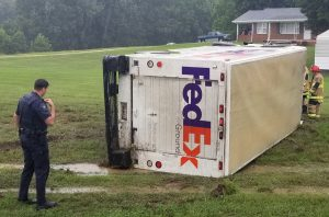 Driver Injured After FedEx Truck Rolls Over in Helen