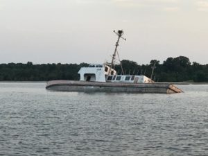 NAS Pax River, U.S. Coast Guard Monitoring Partially Submerged Civilian Craft in Patuxent River