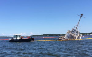 NAS Pax River Successfully Transitions Civilian Watercraft Fuel Leak Containment, Clean Up to U.S. Coast Guard
