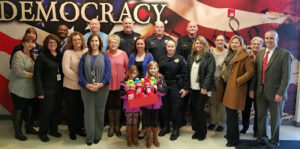 County Finance Staff Give Badges to Sheriff's Office K-9s
