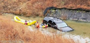 Man and Woman Rescued from a Vehicle in Water in Hughesville