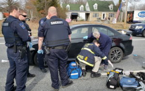 Police and Rescue Personnel Save the Life of Man who Overdosed and Passed Out While Driving