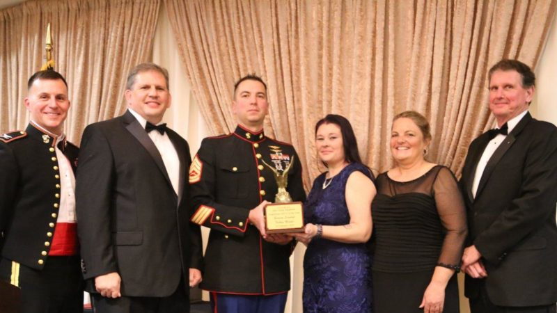 Gunnery Sgt. Nathan Marple, center, receives the Marine Corps' Acquisition Staff Non-Commissioned Officer of the Year award from Marine Corps Aviation Association (MCAA) John Glenn squadron during a ceremony Feb. 28 in Patuxent River, Md. (U.S. Navy photo)