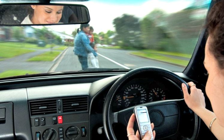 PARK THE PHONE - April is Distracted Driving Awareness Month
