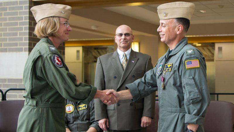 Capt. Lisa Sullivan assumes command of PMA-205 from Capt. Jason Lopez