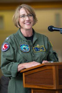 Capt. Lisa Sullivan delivers her remarks at the PMA-205 change of command ceremony