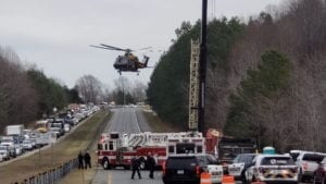 AUDIO: Man Rescued in Calvert After Being Trapped Under Crane Skip Pan in Dump Truck Bed
