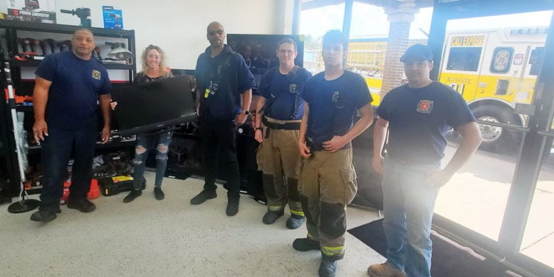 Kim Dennis from Pawnit and Firefighters from Bay District Volunteer Fire Department