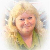 Sharon L. Nielsen, 64