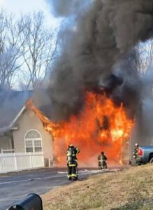 Huntingtown Garage Fire Deemed Accidental Due to Discarded Smoking Materials, Four Occupants and Four Dogs Displaced