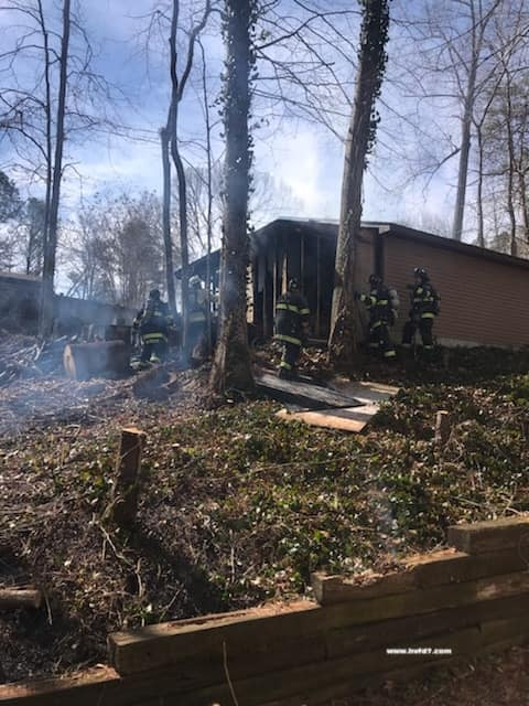 No Injuries Reported After Garage and Brush Fire in Helen