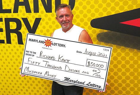 Richard Knott of Leonardtown is all smiles, thanks to his $50,000 Multiplier Money top-prize scratch-off win.